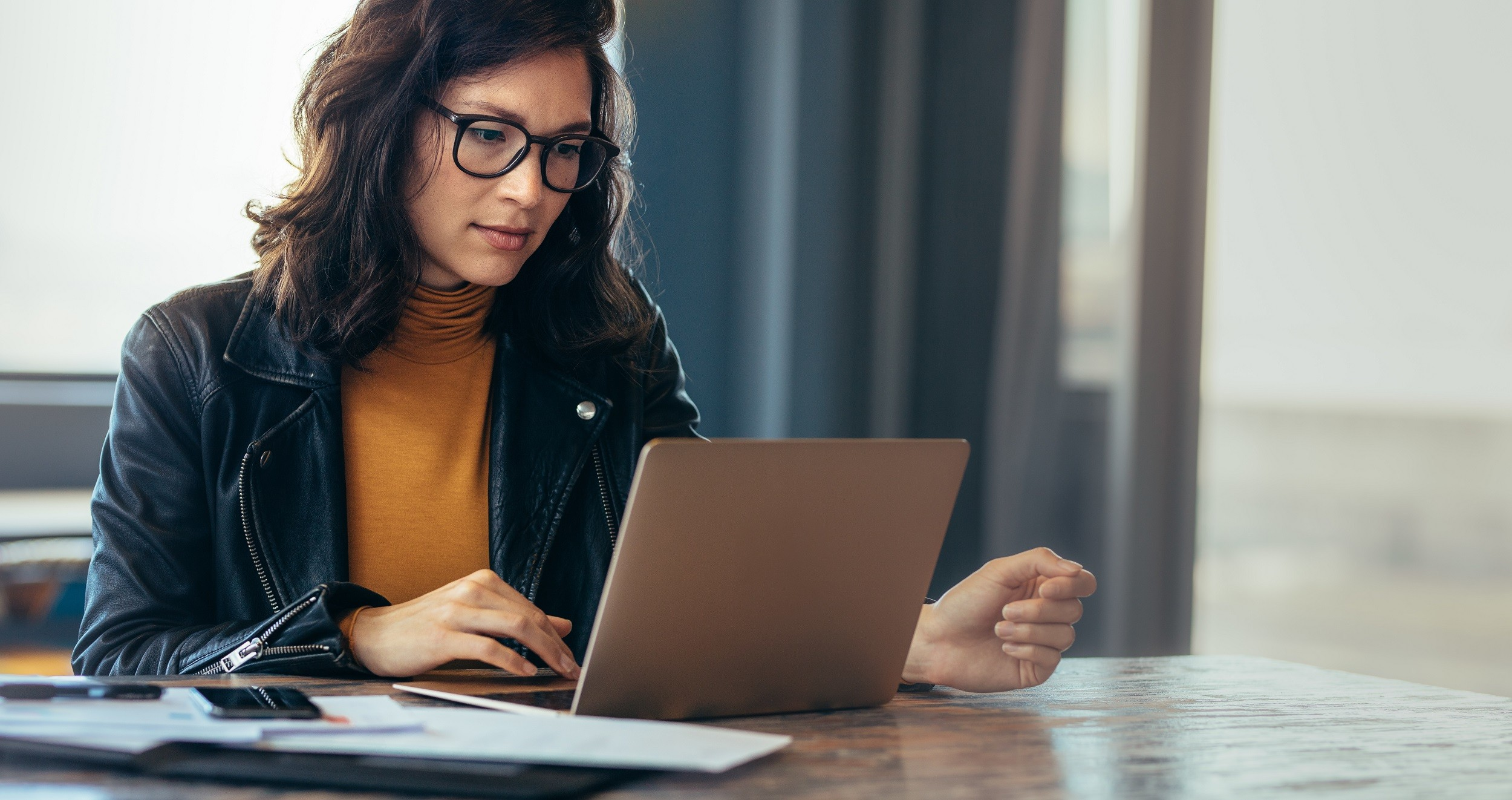Woman working on recycled laptop